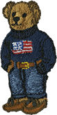 Embroidered male Polo Bear wearing American flag sweater, jeans & loafers