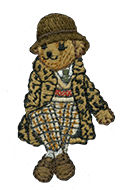 Embroidered female Polo Bear wearing hat, animal-print coat & plaid jodhpurs