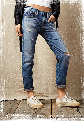 Light-wash distressed jean with cuffs rolled up