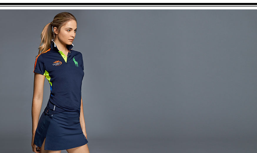 Woman wears navy Polo shirt and navy tennis skirt