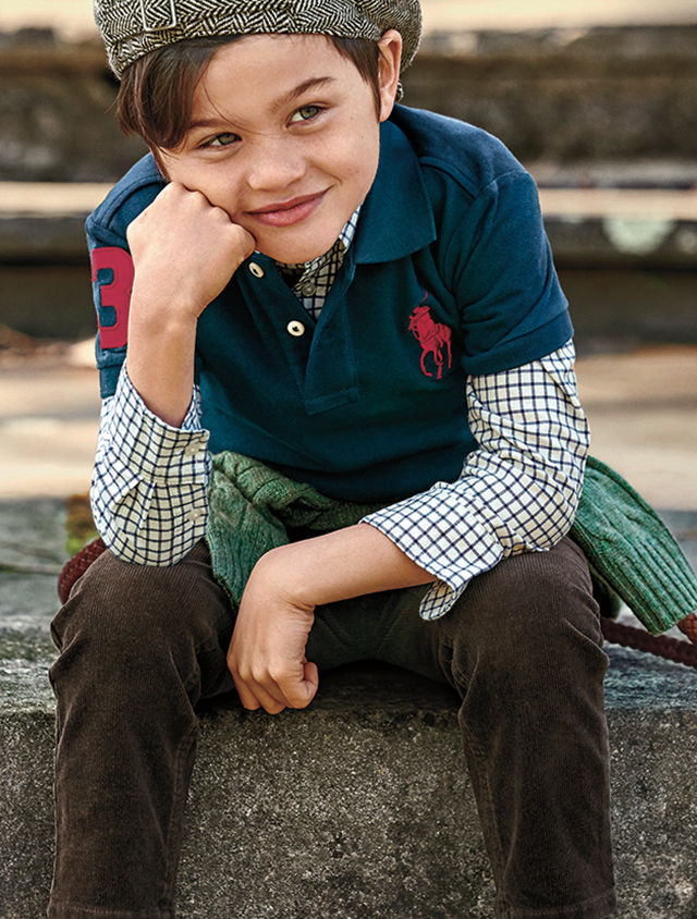 Boy layers navy Big Pony Polo shirt over checked button-down
