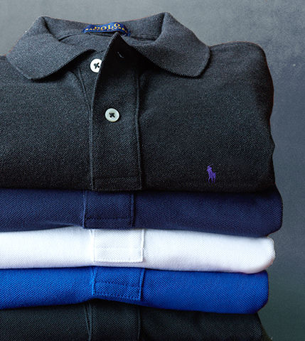 Stack of folded navy, white, black & royal blue Polo shirts
