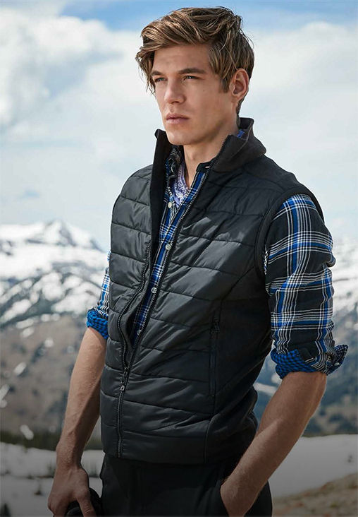 Man in blue-and-black plaid shirt under a black down vest