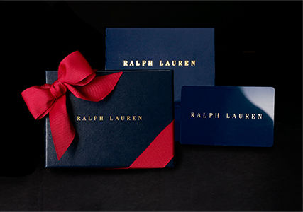 Gift cards pictured with navy gift card box tied with red ribbon