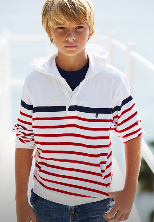Boy models red-and-blue striped Polo hoodie and jeans.